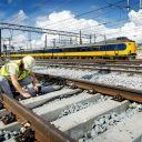 Work on rail tracks, Utrecht Central Station, NS train