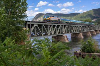 Train on a bridge in Montréal-Québec City by Claude Robidoux