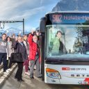 Passengers transfer from train to bus in Switzerland, source: SBB