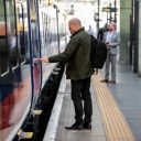 Passenger boarding Paragon bi-mode train of Hull Trains