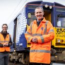 Michael Matheson MSP - Cabinet Secretary for Transport, Infrastructure and Connectivity with Dr. Ben Todd, CEO of Arcola Energy and a 314 Class electric train at the Scotrail Yoker Depot in Yoker, Glasgow with the train that will be converted to run on hydrogen.
