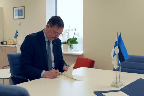 Estonia's Minister Taavi Aas signing the MoA for cooperation